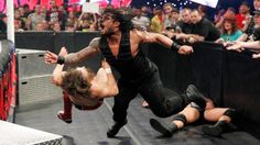 WWE.com: Randy Orton & Daniel Bryan vs. Roman Reigns & Seth Rollins - #WWE Tag Team Championship Match: photos