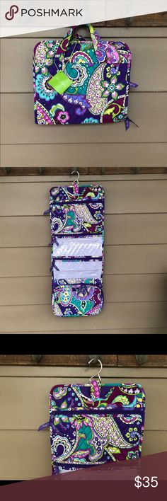 """Vera Bradley Heather Hanging Organizer Brand new with tags a VB Heather Hanging Organizer measurements are (fully opened) 11.5""""W x 29.5""""T x 2.5"""".  Made of 100% quilted cotton. Features carry handles and a tie closure with a hidden Hanger, that easily hanged from a foot hook or knob. Opened there is 1 zippered pocket purple lined, next 2 clear plastic lined pockets, 1 large gusseted pocket that is approximately 10.5"""" x 6.5 & dialed zipper pulls. Great  for at home use, traveling and the…"""