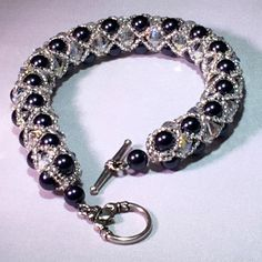 Blue and Crystal Swarovski Pearl Bracelet by swofinc on Etsy. https://www.etsy.com/shop/swofinc
