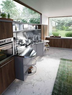 #Cucina #Kitchen #Skyline 2.0 with work units in Platinum grey laminate and…