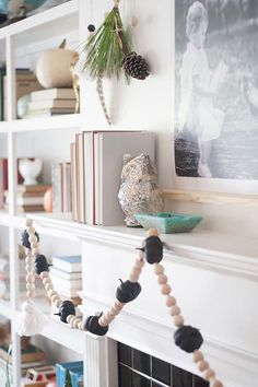 We love the unique garland artist Joni Lay created for her fireplace mantel. It's wooden beads strung with miniature faux pumpkins painted with chalkboard paint for a matte finish.