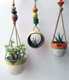 Hanging ceramic pots by Cathy Terepocki