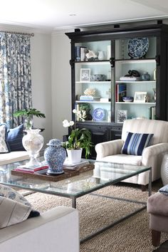 Love the dark bookshelves with the teal backdrop