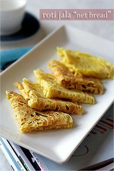 "Roti Jala - means ""net bread"" literally. This is a Malaysian delicacy. Also called Malaysian Lacy Pancakes."
