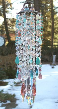 I'm picky about how my wind-chimes sound, but this is freaking gorgeous! Beach glass and crystals and antique fixtures. Love it.
