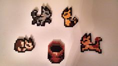 irisofether:  Even more Perler beads! I now have a phalanx of Chrono Trigger kitties, with their cat food. I have to wait until my bead shipment arrives before I can make a Crono for them, though.