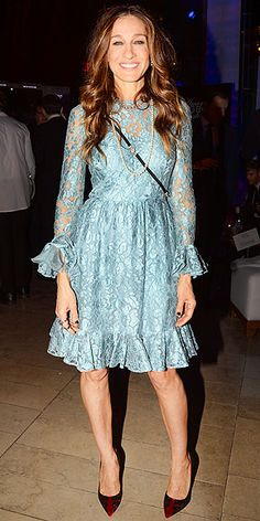 Last Night's Look: Love It or Leave It? | SARAH JESSICA PARKER | Throwback nightgown or dress worth $3,475? Tomato, tom-ah-to. SJP sports the ice-blue lace Dolce & Gabbana complete with wrist and hem ruffles, along with burgundy Rene Caovilla heels and a long strand of Mikimoto pearls to the Great American Songbook event in N.Y.C.