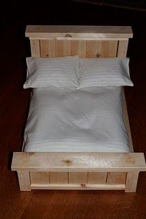Doll bed mattress, pillow, and sheets; SIte has lots of doll accessory and furniture ideas