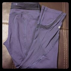 Lululemon Inspire Crop Lululemon inspire crop *blueish/purple coloring with striped waistband, also stopped accents on bottom of leg *size 6 *zippered back pocket * worn only a few times, pants are still in great condition *no tears or rips or stains also no pilling *** with my holiday travel coming up these will only be available until December 18th lululemon athletica Pants