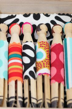 easy easy easy! water based markers, sealed with mod podge + glued fabric dresses.