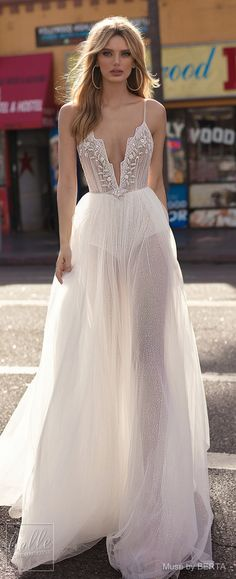 MUSE by BERTA Spring 2019 Wedding Dresses - City of Angels Bridal Collection. Lace A -line wedding dress with deep-v neckline, tulle skirt and spaghetti straps.   Fit and flare sexy bridal gown   Boho bride   Dream dress   backless dress   #weddingdress #weddingdresses #bridalgown #bridal #bridalgowns #weddinggown #bridetobe #weddings #bride #weddinginspiration #weddingideas #bridalcollection #bridaldress #fashion #dress See more gorgeous bridal gowns by clicking on the photo
