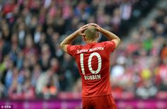 Bayern Munich's Arjen Robben cuts a frustrated figure after missing a chance to score