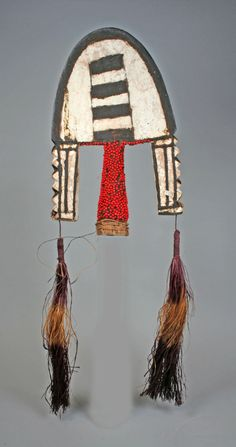 Africa | Headdress from the Jaba or Koro people of the Benue River Valley region of Nigeria | Wood, pigment, abrus seeds, fiber | 20th century