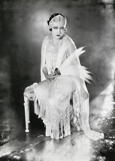 Gloria Swanson, look at her outfit.  Awesome!