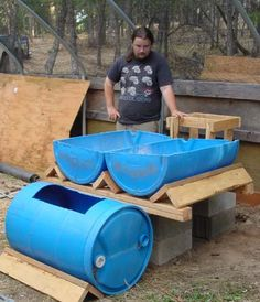 Aquaponics Here is another guy using drums in the same tiered pattern.