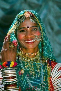 Rajasthani woman covered in jewelry, Pushkar Fair (camel fair), Rajasthan, India