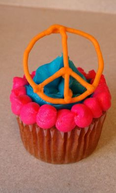 cute cupcake with royal icing peace sign.
