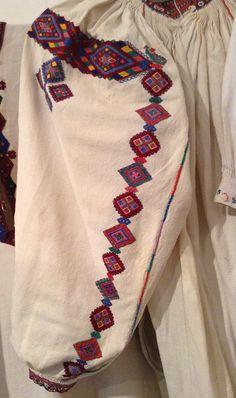 Multicolored embroidery on the sleeve of a female shirt. Transcarpathian region of Ukraine