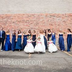 Bridesmaids in all different dresses and colors.....I am in love with this!