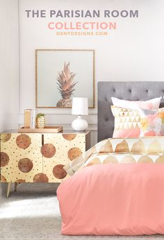 Gold and blush bedroom dreams do come true with this Parisian inspired room from DENYDesigns.com. The geometric duvet cover and floral throw pillow styled with the gold sideboard and pineapple framed wall art, makes for a true Parisian boudoir. This has just enough vintage glam mixed with modern gold home style to bring Paris to life. All that's missing in this bedroom is the Eiffel Tower!