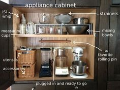 Appliance garage with electrical strip