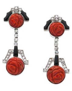 Coral, Onyx, Diamond, Gold Earrings The earrings feature full and single cut diamonds weighing a total of approximately .78 carat, accented by carved coral and onyx, in 18k white gold. Art Deco or Art Deco style.