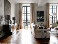 Chic apartment. Cool accent pieces like chest, dramatic proportions of windows, comfy too.