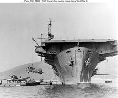 Last US carrier lost in WWII USS Bismarck Sea (CVE-95): A very impressive perspective seeing her bow-on like this, while loading Douglas SBD Dauntless scout bombers from a barge, circa 1944. Possibly at San Diego (Pt. Loma in background)? A Casablanca class escort carrier, she was launched in April, 1944 by Kaiser in Vancouver, Washington. Only 10 months later she would be sunk in action, the eleventh and last American aircraft carrier lost during World War II.