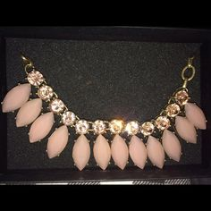Jewelmint pink stone necklace New with tags. Never worn. Approximately 7 inches in circumference. Adjustable band. Kept in original box. Also kept in a pet and smoke free home. Please use offer feature when making offers. Any offers made in the comment section will not be answered. Thank you for stopping by! Jewelmint Jewelry Necklaces