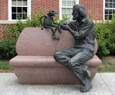 A statue of Jim Henson and Kermit the Frog seated on a red granite bench resides in front of the Adele H. Stamp Student Union at the University of Maryland, College Park, Henson's alma mater.