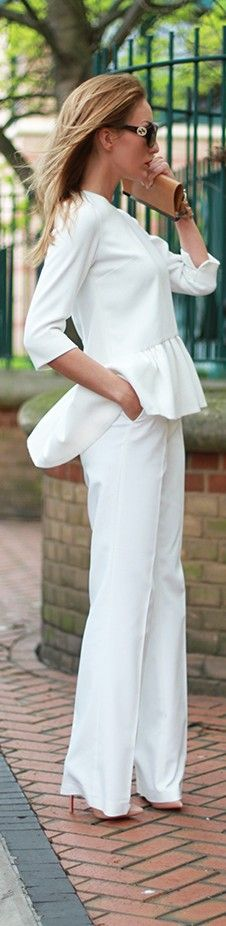 Rarely consider the peplum trend as sleek styling, but this look is crisp classic and very current.