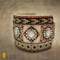 This show stopping cuff is made from swarovski crystals and loomed bead work on a metallic cotton crochet backing. Colors are bold and eye catching Bead Embroidered Bracelet, Beaded Cuff Bracelet, Bead Loom Bracelets, Bead Embroidery Jewelry, Beaded Embroidery, Woven Bracelets, Beaded Jewelry, Handmade Jewelry, Cotton Crochet