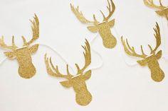 Gold Glitter Deer Garland. $22.00, via Etsy.