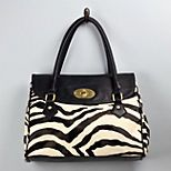 On trend animal hair print handbag from Charming Charlie. Only $35. A great accessory with a black metal ring halter jumpsuit