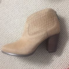 """NWB Ugg western heeled bootie- Charlotte size 7 *NEW WITH BOX* Ugg heeled bootie: Charlotte snake, size 7. Color: """"moon"""" tan calf hair. Heel about 4 inch heel. Zipper closure for easy on and off. Breathable leather lining. 7mm curly UGGpure® insole provides additional comfort. Molded rubber outsole for a pleasurable walking experience. This product contains real fur from Sheep or Lamb from Australia. Real Fur has been artificially dyed and treated. Imported. UGG Shoes Ankle Boots & Booties"""