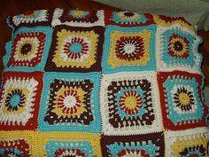 https://flic.kr/p/oLBGG   Granny Square blanket   made by me.