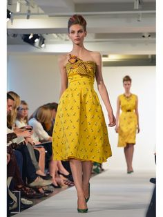 Oscar de la Renta yellow nautical print strapless dress with tied bodice shown during Mercedes Benz Fashion Week Spring/Summer 2013 in New York City. #NYFW #models