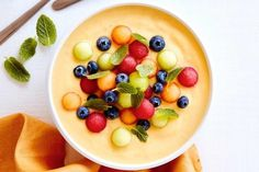 Mango tango: Blend 1 cup (200g) frozen mango, 1 coarsely chopped frozen banana, 1/4 cup (70g) natural yoghurt and 1/2 cup (125ml) coconut water in a blender until smooth. Pour into a serving bowl. Just before serving, top with 2 tbs blueberries, mint leaves and 1/4 cup each of watermelon, rockmelon and honeydew melon. Use a melon baller to scoop out melon balls from halved watermelon, rockmelon and honeydew melon.