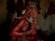 The Himba women of northern Namibia perform daily rituals in which they anoint themselves with a mixture of ochre, oil, and ash to protect themselves from the harsh desert climate. They never take a shower, but rather burn aromatic herbs in a pot each morning with which they smoke themselves as if applying perfume.