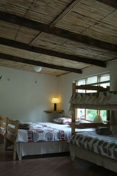 "Inside ""July se huis"" showing the reed ceilings and 4 beds. New Modern House, Self Catering Cottages, Still Working, Open Plan, Ceilings, Beds, The Originals, Furniture, Home Decor"