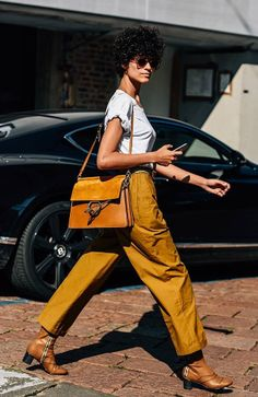 It's no wonder Brazilian model and rising star Ari Westphal already has a Chloe campaign under her belt, with her laid-back style and natural beauty she's the perfect poster girl for the brand. Plus, she knows how to wear it, her Lexie boots and Faye bag pop against her simple white tee and mustard trousers. Straight from Milan fashion week snapped by Mr Tommy Ton #styledotTon