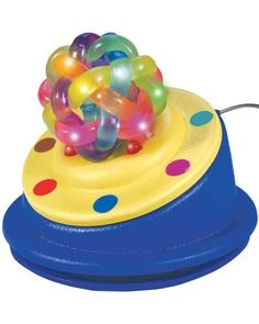 The Textured Orbit Ball Toy Switch plays lights and music, and vibrates subtly when activated. Those can be turned off though and it can be used as a normal switch. -Courage Kenny Rehabilitation Institute