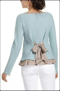 Love the colors and feminine details of this sweater and white jeans.