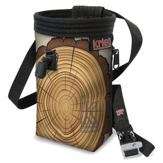 """Tree Stump Chalk Bag. Classic Handmade bag with Water-Resistant Rip-Stop, plated with a Unique Eco-Canvas Print, Reinforced with heavy nylon webbing. Polartek Fleece Lining with an adjustable Snag-Free Draw Cord, and 2"""" elastic grip to keep your chalk clean and where it needs to be. Zippered Pocket which fits the average-sized phone, so take a photo from the top or stash a snack. Adjustable Waist Band with a featured whistle buckle. Life-time Warranty. We love to see our bags used. Give…"""