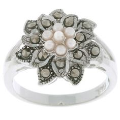 @Overstock - A flower design with marcasite petals and synthetic white pearls in the center gives this ring a look of vintage chic. The ring is crafted of sterling silver with a split band design and a highly polished finish.http://www.overstock.com/Jewelry-Watches/Sterling-Silver-Marcasite-and-Synthetic-Pearl-Floral-Ring/2103517/product.html?CID=214117 $18.99