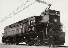 The PRRs first electric, No. stands for a photo on the test track at GEs plant at Erie, Pa. GE built 66 of the big freight-haulers for PRR during 1960 to Electric Locomotive, Diesel Locomotive, New York Central Railroad, Third Rail, Railroad Pictures, Rail Transport, Pennsylvania Railroad, Train Art, Rail Car