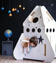 """How to Build a Cardboard Rocket Ship: My son asked Santa for a """"real rocket ship"""" this Christmas to take the family to the moon. Santa has trouble getting rocket fuel this time of year so this is how I built a cardboard rocket. Cardboard Rocket, Cardboard Toys, Cardboard Spaceship, Cardboard Playhouse, Cardboard Furniture, Bed Furniture, Cardboard Design, Fireplace Furniture, Furniture Ideas"""