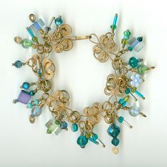 Icy Blue and Green Glass Beaded Cha Cha Bracelet by jodinobles