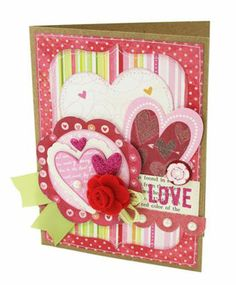 Love this card - would change the colour theme at bit. And get rid of the tacky red rose bit... perhaps a button instead.