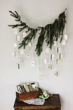 A charming idea for an advent calendar — little matchboxes suspended from a bough, with a thought inside for each day. How to here.